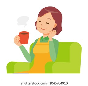 A middle-aged housewife wearing an apron is sitting on a sofa and drinking coffee