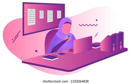 milenial hijabi working desk