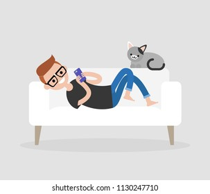 Millennial character lying on a sofa and checking the smartphone. Social networks and apps. Flat editable vector illustration, clip art. Modern lifestyle. Communication technologies.