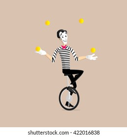 A Mime performing a pantomime - the juggler on the mono cycle