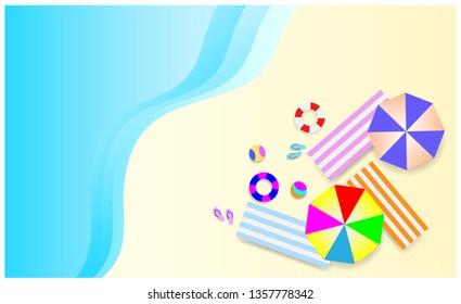Minimal design. top view of summer beach background with umbrellas, balls, swim ring, sandals, beach chair