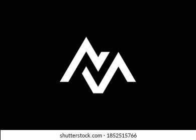 Minimal elegant monogram art logo. Outstanding professional trendy awesome artistic MN NM initial based Alphabet icon logo. Premium Business logo. White color on black background