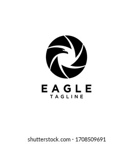 A minimalist logo for a company, community or shop photography that sells photography equipment. A creative logo that blends the camera shutter icon with the eagle delicately and professionally.
