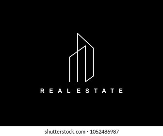 Minimalist real estate logo. Isolated in black background.