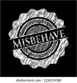 Misbehave written on a blackboard