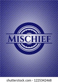 Mischief badge with denim background