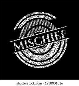 Mischief chalk emblem written on a blackboard