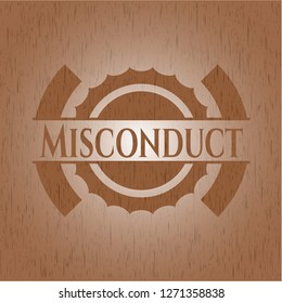 Misconduct badge with wooden background