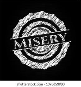 Misery written on a blackboard. Vector Illustration. Detailed.