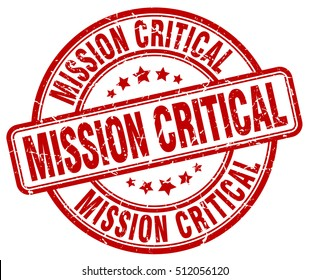 mission critical stamp.  red round mission critical grunge vintage stamp. mission critical