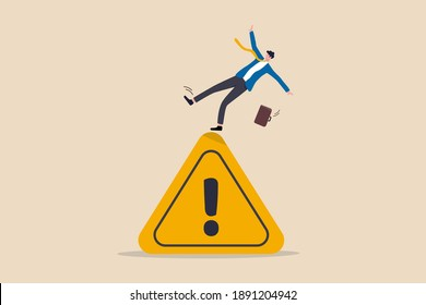 Mistake caution, business risk or problem warning, failure prevention or avoid danger concept, cautious businessman slip falling on exclamation symbol beware, careful caution sign.