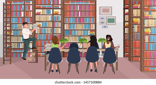 mix race people reading books women sitting at round table man holding books stack on staircase bookstore with bookshelves modern library interior flat horizontal full length