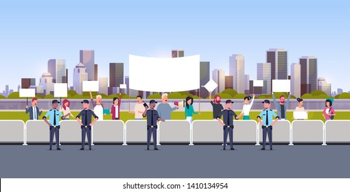 mix race police officers group controlling people crowd with placards and megaphone at protest demonstration strike concept city street cityscape background flat horizontal full length
