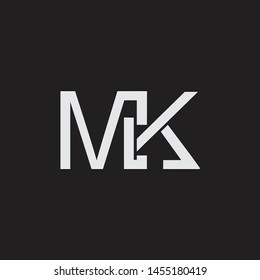 MK intial logo Capital Letters black background
