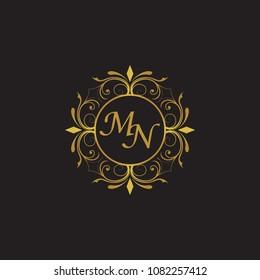 MN Initial logo. Ornament ampersand monogram golden logo black background