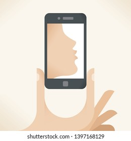 Mobile kiss message. Man hand with smartphone with kissing woman silhouette on screen. Concepts: online relationships, social networking, chat, love, romance and flirting, Valentines day etc.