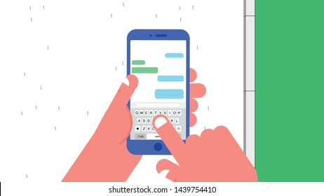 Mobile phone in the left hand of walking person on street. Message application is in the mobile phone screen.