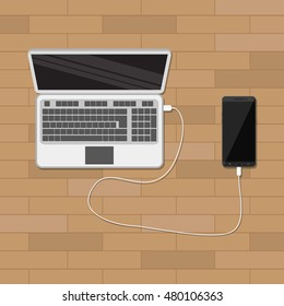 mobile phone plugged and charging from laptop usb port. vector illustration in flat style. wooden background