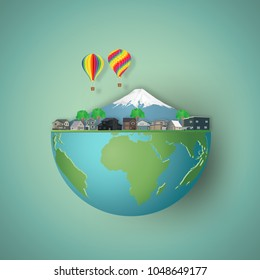 Modern buildings cityscape, houses, mountain with colorful balloons on hemisphere green world as business, nature, eco and love earth day concept. vector illustration of paper art and craft style.