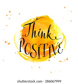 Modern calligraphy inspirational quote - think positive - at yellow watercolor background