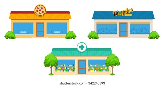 Modern city store buildings with trees and bushes