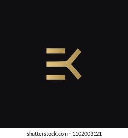 Modern creative geometric shaped EK KE E K artistic minimal black and golden color initial based letter icon logo.