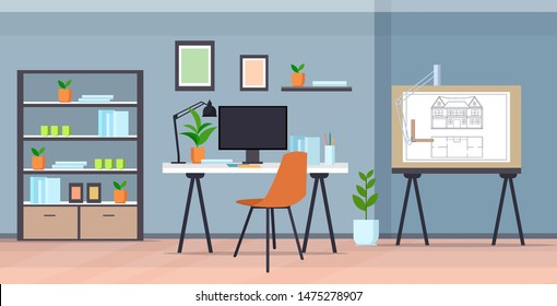 Modern draftsman studio. Blueprint with new house plan on board. Designer architect workplace office interior.