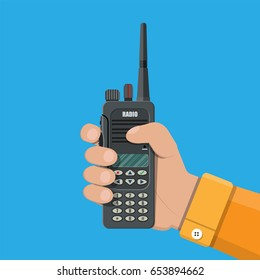 Modern portable handheld radio device in hand. Vector illustration in flat style