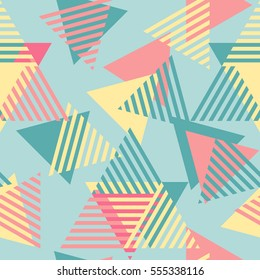 Modern stylish abstract geometric background with colorful triangles in trendy Memphis style. Repeating texture of yellow, blue and red elements on the blue background. Vector seamless pattern.