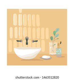 Modern, stylish bathroom. The decor and design of the bathroom. Washbasin, soap and toothbrushes. Wall tiles and eucalyptus in a vase.