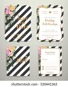 Modern wedding invitation card set on black and white stripe background on wood background