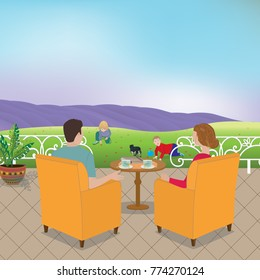Mom and Dad sitting on the terrace watching the children playing on the meadow. In the horizon is a field of lavender