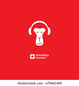 Monkey enjoys the music. Relaxing monkey in headphones. Logo for music studio