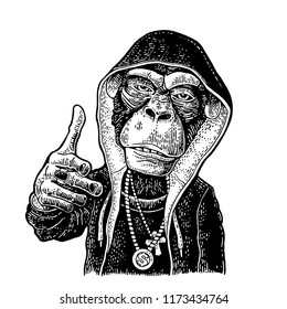 Monkey rapper dressed in the hoodie, necklace with dollar, cross. Showing symbol Like. Vintage black engraving illustration. Isolated on white background. Hand drawn design element for poster, t-shirt