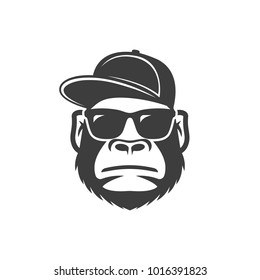 Monkey in sunglasses and a cap. Cool gorilla icon