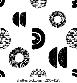 Monochrome minimalistic tribal seamless pattern with ethnic sun, crescent, arcs, ball. Inspired by signs of primitive aboriginal culture. Vector background with black art on white backdrop for nursery