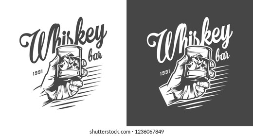 Monochrome whisky bar logotype with male hand holding glass of strong alcohol and ice cubes in vintage style isolated vector illustration