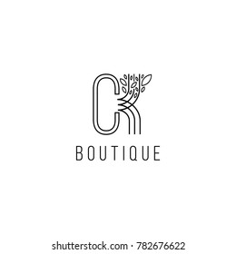 Monogram design in the form  of a tree, graceful template. Calligraphic elegant line art logo design. C,K letters emblem sign  for Royalty,  Boutique, Hotel, Heraldic, Jewelry, fashion store.