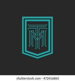 Monogram letters TM logo hipster frame form shield, crest blue and black combination T M initials mockup emblem business card