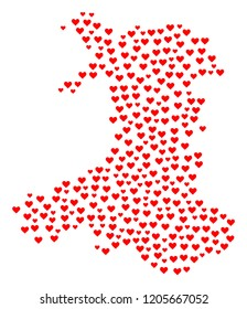 Mosaic map of Wales composed with red love hearts. Vector lovely geographic abstraction of map of Wales with red romantic symbols. Romantic design for bonus projects.