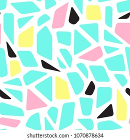 Mosaic memphis style geometric seamless pattern. Terrazzo flooring. Broken glass, stained glass, stone texture. Blue, pink, yellow elements on white background. Modern vector design for textile print.