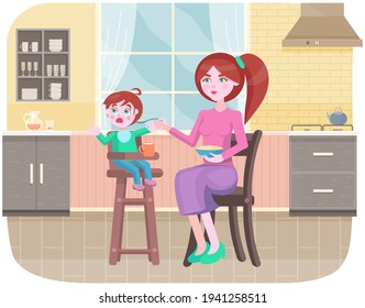 Mother feeding her little daughter sitting in high chair in kitchen. Woman gives her child porridge