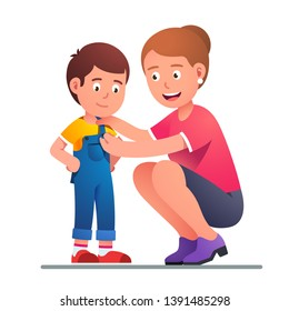 Mother helping boy son to dress up or change clothes. Parent button up kid jumpsuit. Parenting undressing or dressing up happy smiling child. Flat vector character illustration