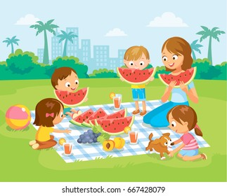 Mother with kids at the park eating fruits and watermelon. Summer picnic.