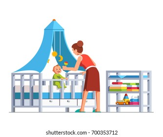 Mother playing rattle to little baby son toddler sitting in crib bed or cot. Woman babysitter looking after newborn boy. Mum and child in kids room. Family childcare. Flat cartoon vector illustration.