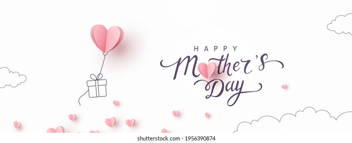 Mother's day postcard with paper flying elements and gift box on white sky background. Vector symbols of love in shape of heart for greeting card design - Shutterstock ID 1956390874