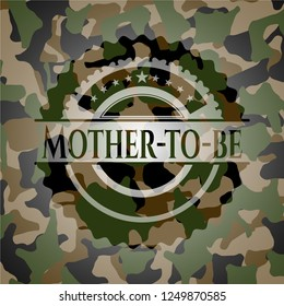 Mother-to-be on camo pattern