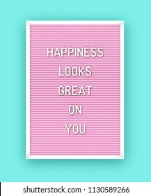 Motivation quote on pink letterboard with white plastic letters. Hipster vintage inspirational poster 80x, 90x. Happiness looks great on you