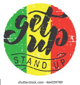 Motivational quote ''Get up, stand up''. Grunge texture. Reggae flag round background. Hand lettering calligraphic typography. Usable for t-shirts, posters, stickers...