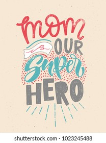 Motivational quote in vector. Mom is our SUPERHERO. Isolated on beige vintage background handwritten lettering. Calligraphic poster for 8 march or Mothers day holiday.